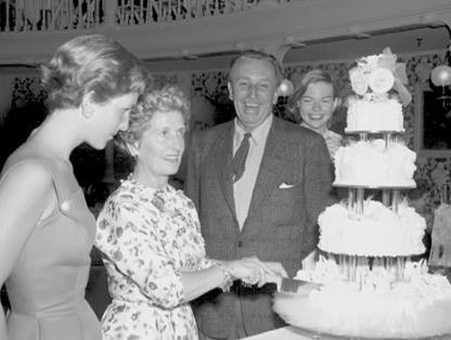 Walt and Lillian, with daughter Diane, left, and Sharon, right, celebrating their 30th anniversary at the Golden Horseshoe just 4 days before Disneyland's grand opening in 1955.